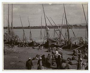 Feed boats (trodden straw) unloading on the Nile, Egypt..jpg