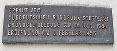Commemorative plaque at the tower's base