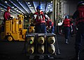 Flickr - Official U.S. Navy Imagery - A Sailor prepares to rig an ordnance pallet in the hangar bay of USS George H.W. Bush..jpg