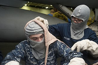 Field dressing (bandage) - A Sailor wraps a field dressing around a casualty's head.