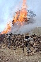 GIs burn a house described as a Taliban safehouse