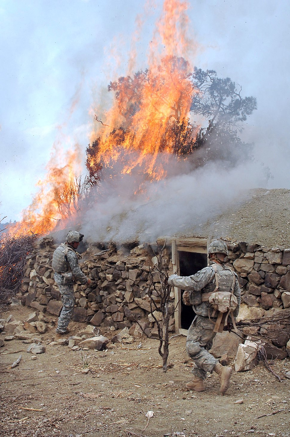 GIs burn a house described as a Taliban safehouse