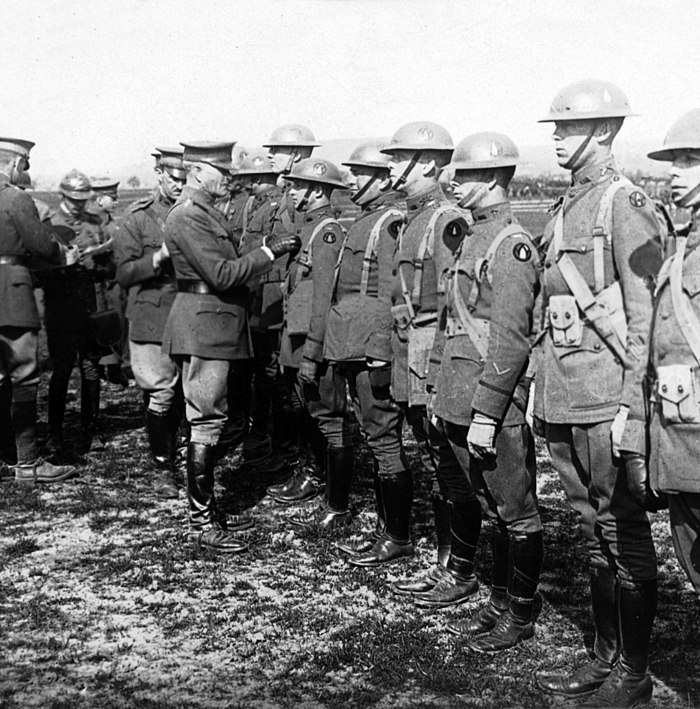 Gen Pershing decorating soldiers in Trier c1919