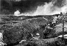 German stormtroops training with a flamethrower in a dummy trench system near Sedan, France, May 1917