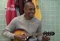 Gilberto playing mandolin.png