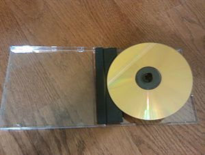 Gold compact disc - A gold CD in a lift-lock case