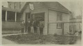 Great Kills, Exterior, boys in front of William P. Merrell insurance & real estate office (NYPL b11524053-1252663).tiff