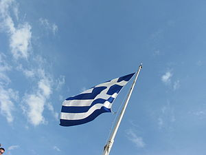 The flag of Greece on the top of the the Acrop...