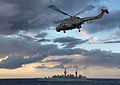 HMS Cumberland's Lynx Returns to 'Mother' During Operation Ellamy MOD 45152537.jpg