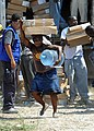 Haitian residents receive shelter packages and water distributed by the International Organization for Migration in Port-au-Prince, Haiti 100224-N-HX866-008.jpg