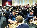 Handschlag vor dem Einschalten der Uhren - 13. WM-Schnellschachrunde 2015.JPG