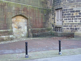 "Lancaster Castle - ""Hanging Corner"" – the site of public executions until 1865. The double doors on the right led to the gallows situated in front of the sealed archway."