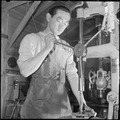 Heart Mountain Relocation Center, Heart Mountain, Wyoming. A young machinist operates a drill press . . . - NARA - 539258.tif