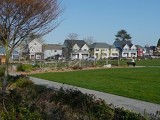West Seattle, Seattle - Community garden and open play field with typical house variety in background.