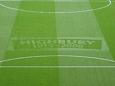 "A football pitch with ""Highbury 1913–2006"" emblazoned on the grass: Arsenal played home matches at Highbury between those years."