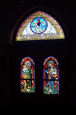Holy Family Church (Columbus, Ohio), interior, view of front door stained glass from the vestibule.jpg