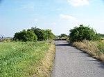 Hostivice, bývalá silnice Sobín - Kněževes, u letiště a silnice R6.jpg