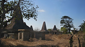 Sumbanese traditional house - A striking feature of a Sumbanese village is that houses intermingle with tombs.