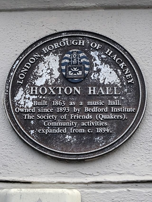 Brown plaque № 8585 - Hoxton Hall  Built 1863 as a music hall.  Owned since 1863 by Bedford Institute.  The Society of Friends (Quakers)  Community activities  expanded from c 1894