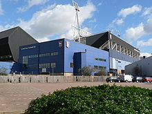 The Sir Alf Ramsey Stand of Portman Road, including one of the ground's floodlights