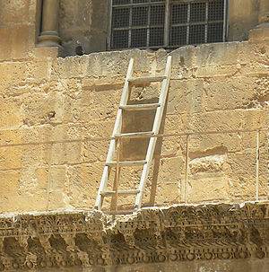 Status quo of Holy Land sites - The Immovable Ladder. Detail from photograph of the façade of the main door to the Church of the Holy Sepulchre, Jerusalem, 2011.