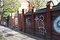 Indira-Gandhi-Straße 110 Friedhofsmauer mit Portal (Berlin-Weißensee).jpg