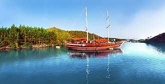 Blue Cruise - Traditional two-masted gulet schooner visiting a cove in Gökova as part of the Blue Voyage