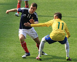 James McArthur - James McArthur being defended by Neymar Jr. in a friendly match between Scotland and Brazil in March 2011