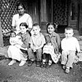 James and Lois Kniss with playmates, Landour, India, 1962 (16326391083).jpg
