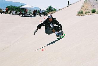 Slalom skateboarding - A slalom skateboarder.