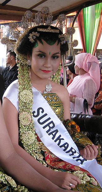 Jasminum sambac - Javanese Surakarta bride adorned with intricate roncen melati (jasmine garland).