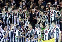 Juventus captain Giorgio Chiellini is handed the Coppa Italia by the President of the Republic