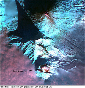 Kamen (volcano) - Kamchatka volcanoes: Klyuchevskaya Sopka (top), Bezymianny (bottom), both in activity, and the Kamen (middle).