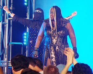Cheerleader Melissa - Anderson as Raisha Saeed (left), Awesome Kong's (right) manager