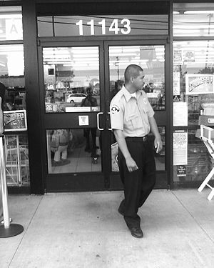 A security guard at a 7-Eleven store in Los An...