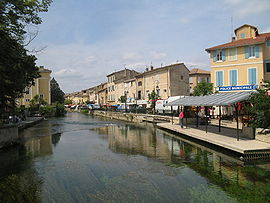 The village of L'Isle-sur-la-Sorgue, with the river in the foreground