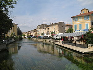 L'Isle-sur-la-Sorgue - The village of L'Isle-sur-la-Sorgue, with the river in the foreground