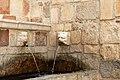 L'aquila, fontana delle 99 cannelle, mascheroni 08.jpg