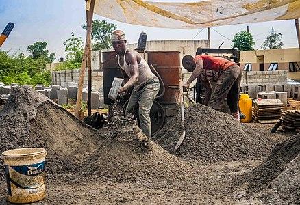 Labourers mixing Cement.jpg