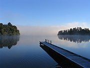 A pier on Lake Mapourika in New Zealand illustrates the simplest form of pier