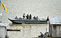 Lancha conduz fuzileiros navais no rio Purus onde ocorreu treino da Operação Amazônia 2012 (8030641534).jpg