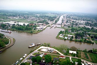 Bayou Lafourche - The intersection of Bayou Lafourche and the Gulf Intracoastal Waterway at Larose, Louisiana. View is to the east-southeast. The bayou runs off towards the Gulf at the top. The waterway crosses the picture left–right. The U.S. Army Corps of Engineers has installed a floodgate on the bayou, visible at center.