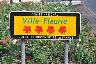 Concours des villes et villages fleuris - Sign in Le Vésinet (4 flowers).