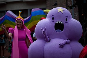 The image depicts two individuals dressed up as characters from the show