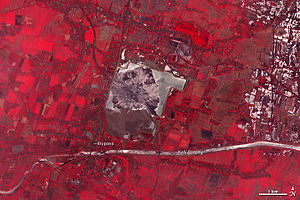 Sidoarjo mud flow - August 28, 2004 (top), November 11, 2008 (middle) and October 20, 2009 (bottom) views of the Sidoarjo mud flow. Red areas indicate vegetation in these NASA ASTER false-color satellite images.