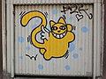 M. CHAT sur une porte de garage.jpg