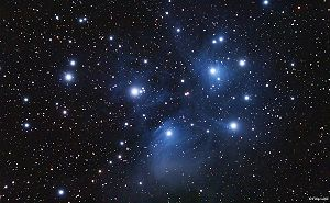 Star cluster - The Pleiades, an open cluster dominated by hot blue stars surrounded by reflection nebulosity.