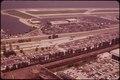MOVING CARS AND PARKED CARS AT POPULAR LAKESIDE BEACH - NARA - 550104.tif