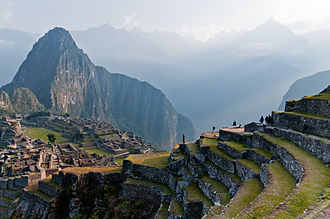 State formation - The mountain Huayna Picchu overlooks the ruins of Machu Picchu. The Andes mountains circumscribed much of the region.
