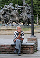 Man in front of dancing statues, Tbilisi.jpg